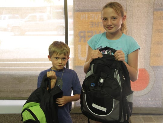Kids came to pick up their backpacks filled with supplies