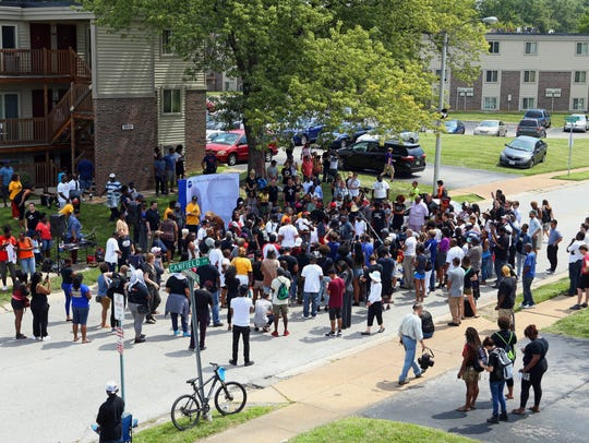 Michael Brown's family is surrounded by supporters