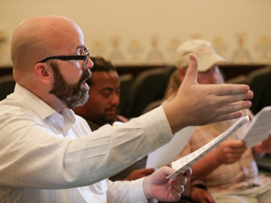 Choir director Jason Fishburn leads members in song during Matthew's Voices: Side-by-Side community choir practice at Roberts Park United Methodist Church, 401 N. Delaware St.