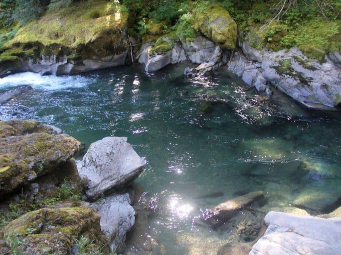 """""""Canyon Pool,"""" a swimming hole between canyon walls"""