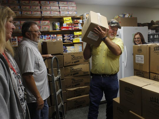 Approximately 5,400 boxed meals were donated Monday afternoon to the Milan Mustard Seed.
