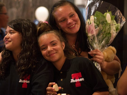 Barbara Aleman, right, stands holding flowers with two of her four daughters after graduating from the Reno Works program on Aug. 18.