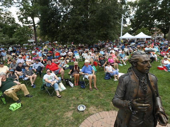 Visitors enjoy legendary guitarist Bucky Pizzarelli and his long-time partner, Ed Laub, at the annual Morristown Jazz and Blues Festival on the historic Morristown Green.