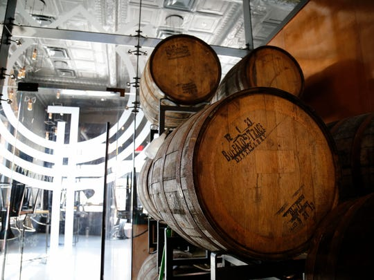 A stack of bourbon barrels in the brewing section at