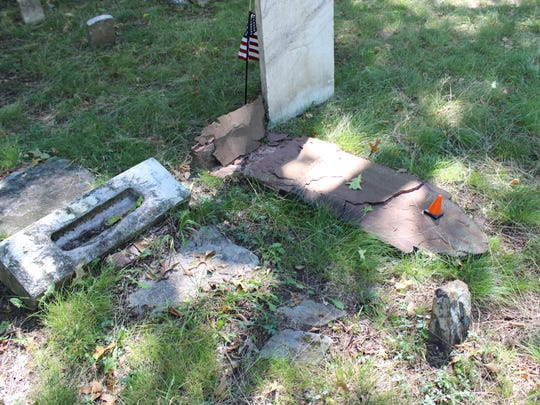 Police said vandals forcefully knocked over about 10 gravestones that were grouped together in the Old Colonial Cemetery of Metuchen.