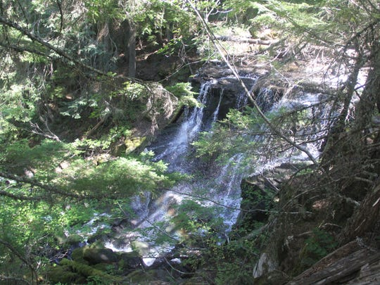 A small, 30-foot waterfall sits between Lower and Middle Erma Bell lakes.