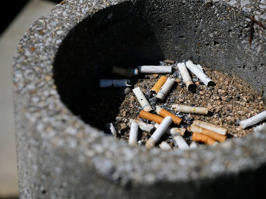 Discarded cigarettes lay in an ashtray outside of Baldwin
