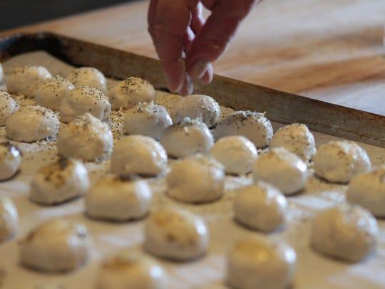 Executive Chef Mike Schnupp seasons dinner rolls at