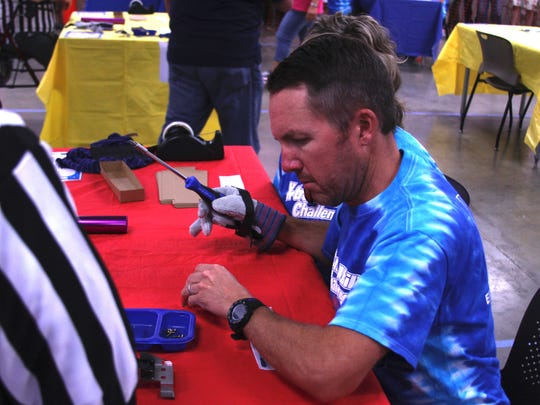 Reno City Councilman David Bobzien uses a glove to simulate a manual disability at the X-Treme Ability Challenge on Aug. 20, 2016.