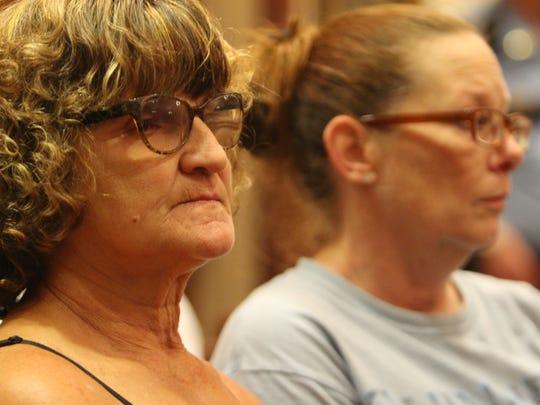 Roxane Fruin, left, listens Thursday as a jury acquits