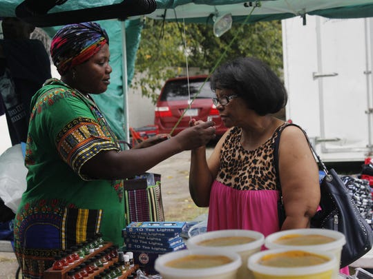 Foureratou Seyni, who emigrated to the United States from Niger 15 years ago, came to the 27th annual African Street Festival in Jackson to sell her all-natural hand cream.