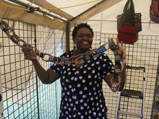 Phylis Anyango displays some of the handmade Kenyen jewelry she is selling at this year's African Street Festival