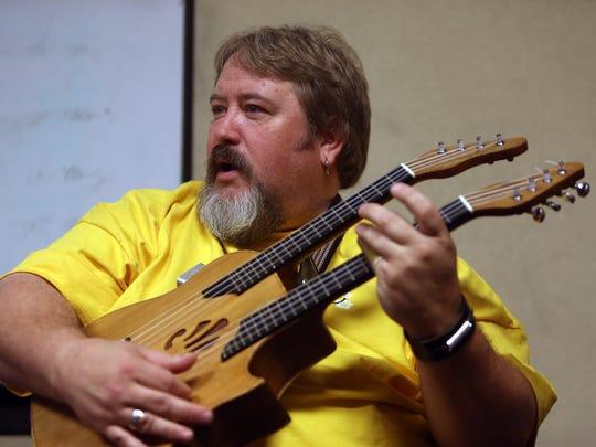 Ukulele bluesman Manitoba Hal Brolund of Nova Scotia teaches use of a slide on the ukulele during a workshop at the Folk Project's fourth annual ukulele festival at the Ukrainian American Cultural Center. August 27, 2016, Whippany, NJ