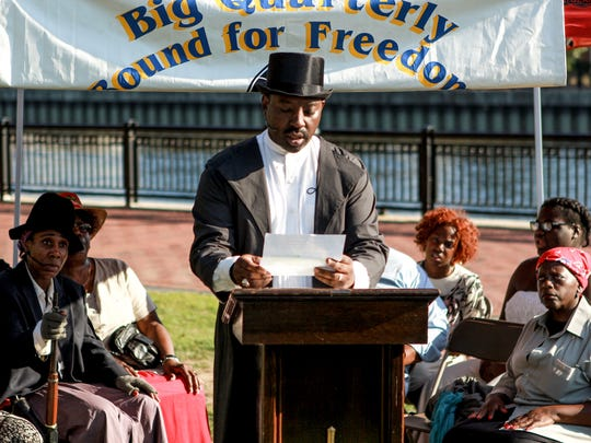 Emile Brown speaks to the crowd at the Tubman-Garrett Riverfront Park in Wilmington on Sunday, Aug. 28, 2016.