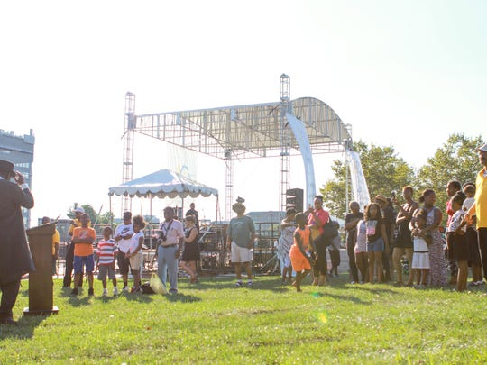 Crowds gather around to listen to the story and speech given by Emile Brown at the Tubman-Garrett Riverfront Park in Wilmington on Sunday, Aug. 28, 2016.