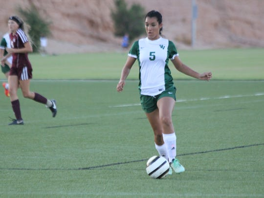 Virgin Valley's Karla Correa dribbles the ball during Friday's Mesquite Cup match against Pahrump Valley.