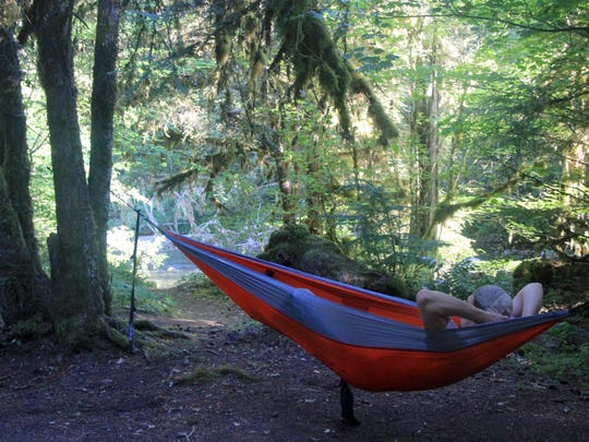Hammocks make a great way to relax at a forested campsite along a stream, in this case the North Fork Middle Fork Willamette River.