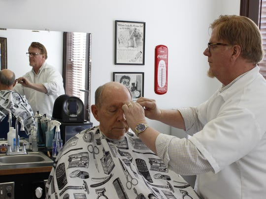 Sam Birch, the Atlanta-based barber who opens shop in Lafayette on the weekends, cuts hair one Saturday in 2014.
