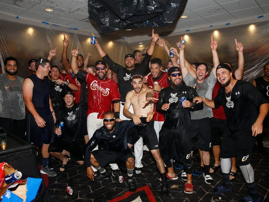After showering Chihuahuas Manager Rod Barajas the