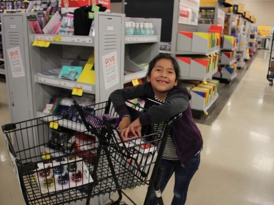 Lynette Montes, 7, shops for the new school year at a local  OfficeMax.