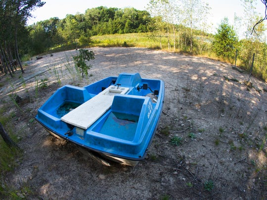 An unused paddle boat is high and dry on what used to be covered with water on Long Lake.