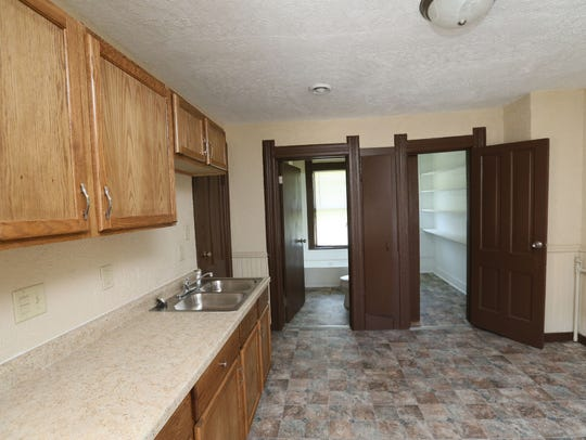 A duplex on W. Center owned by Divine Momentum has