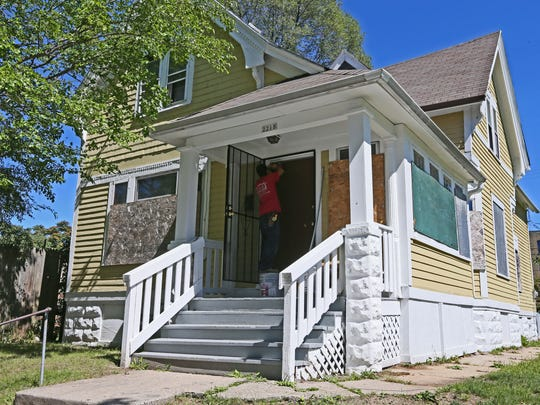 Gabriel Perez of A&A Contractors LLC works on a house owned by Divine Momentum in Milwaukee.