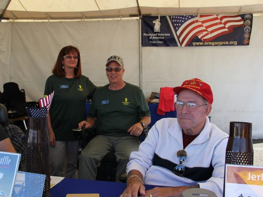 Dave Parker, right, speaks to visitors. Park, a disabled veteran who served for 24 years in the Marine Corps, has been volunteering with Paralyzed Veterans of America since 1980.