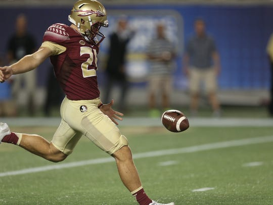 FSU's Logan Tyler punts the ball during their game