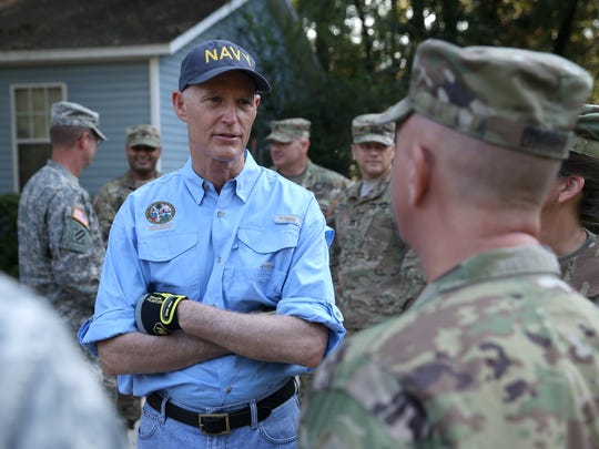 Gov. Rick Scott chats with Florida National Guard members,
