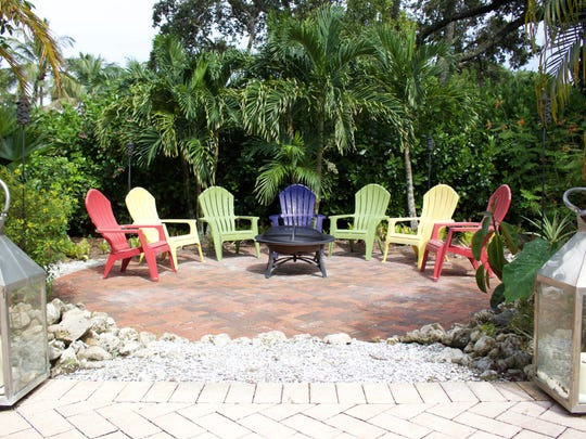 Cris Perdzock hosts friends and family for dinner parties and cocktail hours in her Naples backyard.