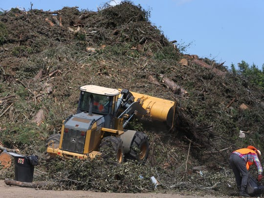 Over 2,200 tons of fallen trees and yard waste is piled