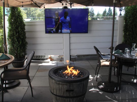 The Black Tee Lounge, the newly renovated upstairs dining space at Rudy's Restaurant, opens for service at 11 a.m. Sept. 9, 2016. The outdoor seating space features outdoor fireplaces and a flat-screen television. BROOKE JACKSON-GLIDDEN/Statesman Journal