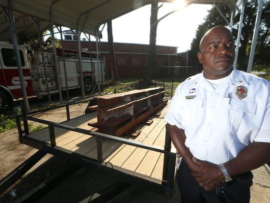 Tallahassee Fire Department Battalion Chief Jarvis Bedford stands next to an I-beam that was a part of the World Trade Center before the attacks of September 11, 2001. Bedford led local fundraising efforts, raising $70,000 to help fund the Rescue One team in New York, the fire department unit most heavily hit by casualties.