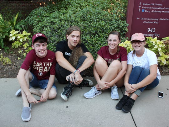 Students Andrew Burns, James Picker, Anna Alderson and Amanda Taylor wait to donate blood before going to see the movie You Before Me at the SLC.