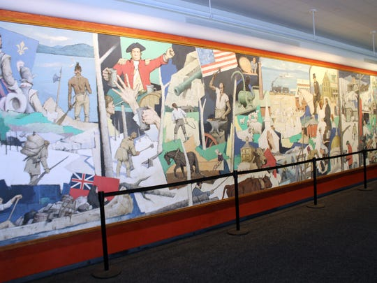 "This photo provided by the National Life Group shows a massive mural that has been donated to the Vermont Historical Society, where it will be preserved and protected. The mural called ""A Tribute to Vermont"" by Paul Sample has been hanging in the lobby of insurance company National Life Group's headquarters in Montpelier, Vt. since 1961."