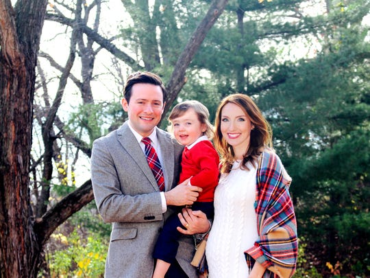 Eric and Kate Wagner pose for a family photo with their