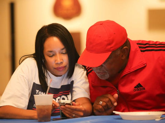 Sophia Hanson (left) and Muhammad Salaam check election results during a primary election watch party for New Castle County Executive Thomas P. Gordon at the New Castle County F.O.P. in Wilmington Tuesday. Gordon  was defeated by Matt Meyer.