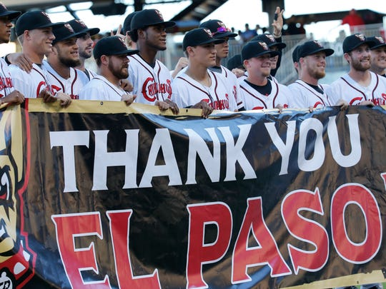 "El Paso Chihuahuas players hold up a banner on the home dugout side that read ""Thank You El Paso,"" for the support they say that the fans of the CHihuahuas gave them during the recent season. The Chihuahuas took game one of the series 7-5 of the PCL Championship Series."