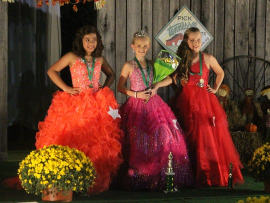 Jayden Lewis, center, was crowned Young Miss Fairest