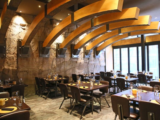 """Carnevor this year moved a couple of doors away to 718 N. Milwaukee St. The modern dining room re-creates a version of the wooden """"ribs"""" from Carnevor's previous home."""