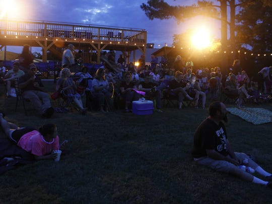 A crowd gathers at the AMP for the first ever Reels at the AMP movie night Friday.