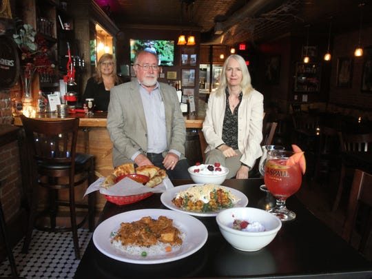From left, McDonald and Peacock Cider Bar co-owners Dennis Duffy and Joy Court inside their Peekskill establishment Sept. 15, 2016.