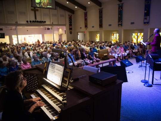 Eleanor Phelps, far left, plays the organ while Dan Dickout sings to a packed house during the St. Matthews benefit concert at East Naples United Methodist Church on Sunday, Sept. 18, 2016. St. Matthew's House strives to fight hunger, homelessness and addiction in SW Florida.