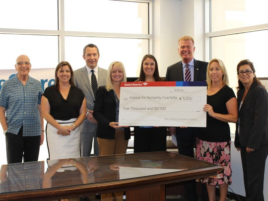 Members of the Board of Directors of Habitat for Humanity Coachella Valley receive   $5,000 grant from Bank of America Charitable Foundation representatives.