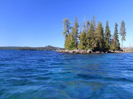 One of the larger islands is seen on Waldo Lake.