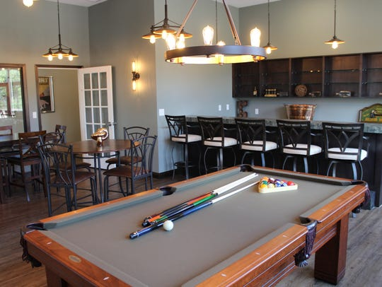 Members can enjoy happy hour and a game of billiards
