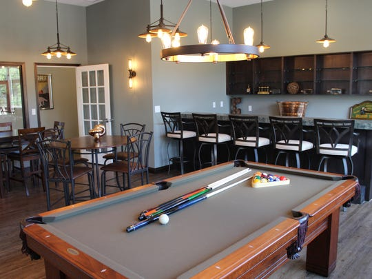 Members can enjoy happy hour and a game of billiards at Hilltop Grand Village.