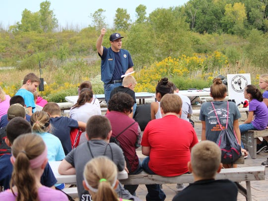 Nicholas Moore, of the Ottawa National Wildlife Refuge, speaks to fifth grade students during the annual school tour.