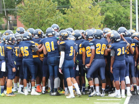 Northeast's team gathers in a huddle just before its Jamboree game against Montgomery Central last month.